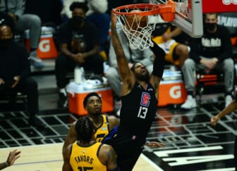 Jun 14, 2021; Los Angeles, California, USA; Los Angeles Clippers guard Paul George (13) scores a basket against the Utah Jazz during the first half in game four in the second round of the 2021 NBA Playoffs. at Staples Center. Mandatory Credit: Gary A. Vasquez-USA TODAY Sports