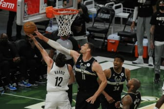 Jun 17, 2021; Milwaukee, Wisconsin, USA; Milwaukee Bucks center Brook Lopez (11) blocks the shot of Brooklyn Nets forward Joe Harris (12) in the first quarter during game six in the second round of the 2021 NBA Playoffs at Fiserv Forum. Mandatory Credit: Michael McLoone-USA TODAY Sports