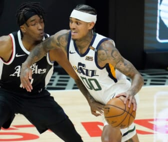 Jun 18, 2021; Los Angeles, California, USA; Utah Jazz guard Jordan Clarkson (00) dribbles the ball past LA Clippers guard Terance Mann (14) in the second quarter during game six in the second round of the 2021 NBA Playoffs at Staples Center. Mandatory Credit: Robert Hanashiro-USA TODAY Sports