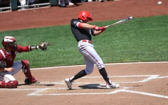 Jun 19, 2021; Omaha, Nebraska, USA;  NC State Wolfpack outfielder Jonny Butler (14) singles in two runs in the fourth inning against the Stanford Cardinal at TD Ameritrade Park. Mandatory Credit: Steven Branscombe-USA TODAY Sports