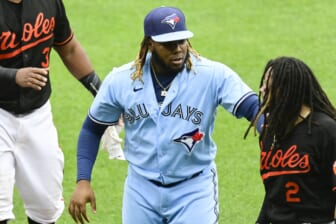 Jun 19, 2021; Baltimore, Maryland, USA; Toronto Blue Jays designated hitter Vladimir Guerrero Jr. (27) hold Baltimore Orioles shortstop Freddy Galvis (2) back after benches cleared in the fourth inning at Oriole Park at Camden Yards. Mandatory Credit: Tommy Gilligan-USA TODAY Sports