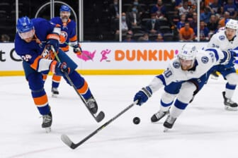 Jun 19, 2021; Uniondale, New York, USA; New York Islanders defenseman Scott Mayfield (24) attempts two clear the puck defended by Tampa Bay Lightning center Blake Coleman (20) during the first period in game four of the 2021 Stanley Cup Semifinals at Nassau Veterans Memorial Coliseum. Mandatory Credit: Dennis Schneidler-USA TODAY Sports