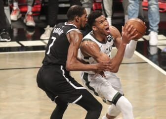 Jun 19, 2021; Brooklyn, New York, USA; Milwaukee Bucks forward Giannis Antetokounmpo (34) drives past Brooklyn Nets forward Kevin Durant (7) in the third quarter during game seven in the second round of the 2021 NBA Playoffs at Barclays Center. Mandatory Credit: Wendell Cruz-USA TODAY Sports