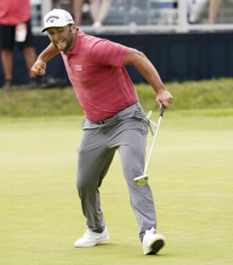 Jun 20, 2021; San Diego, California, USA; Jon Rahm reacts to his birdie putt on the 18th green during the final round of the U.S. Open golf tournament at Torrey Pines Golf Course. Mandatory Credit: Michael Madrid-USA TODAY Sports