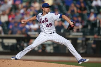Jun 21, 2021; New York City, New York, USA; New York Mets starting pitcher Jacob deGrom (48) pitches against the Atlanta Braves during the third inning at Citi Field. Mandatory Credit: Brad Penner-USA TODAY Sports