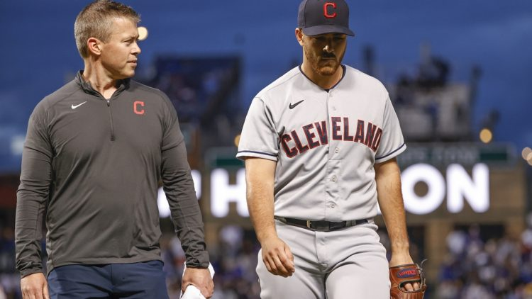 Jun 21, 2021; Chicago, Illinois, USA; Cleveland Indians starting pitcher Aaron Civale (43) leaves a baseball game against the Chicago Cubs due to injury during the fifth inning at Wrigley Field. Mandatory Credit: Kamil Krzaczynski-USA TODAY Sports