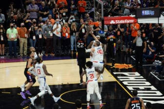 Jun 22, 2021; Phoenix, Arizona, USA; Phoenix Suns center Deandre Ayton (22) dunks over LA Clippers center Ivica Zubac (40) in the final second during the second half of game two of the Western Conference Finals for the 2021 NBA Playoffs at Phoenix Suns Arena. Mandatory Credit: Joe Camporeale-USA TODAY Sports