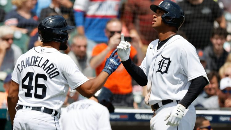 Jun 23, 2021; Detroit, Michigan, USA;  Detroit Tigers first baseman Jonathan Schoop (7) receives congratulations from third baseman Jeimer Candelario (46) after he hits a home run in the fifth inning against the St. Louis Cardinals at Comerica Park. Mandatory Credit: Rick Osentoski-USA TODAY Sports
