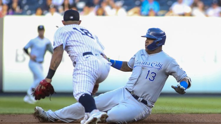 Jun 23, 2021; Bronx, New York, USA; Kansas City Royals catcher Salvador Perez (13) slides into second base after hitting a double in the first inning against the New York Yankees at Yankee Stadium. Mandatory Credit: Wendell Cruz-USA TODAY Sports