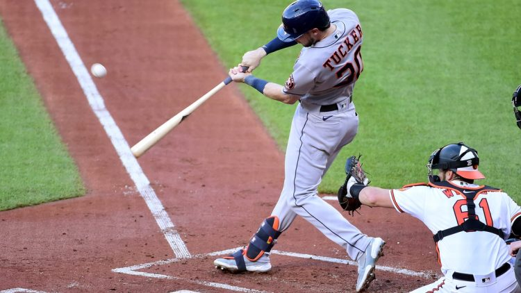 Jun 23, 2021; Baltimore, Maryland, USA; Houston Astros outfielder Kyle Tucker (30) hits an RBI single in the first inning against the Baltimore Orioles at Oriole Park at Camden Yards. Mandatory Credit: Evan Habeeb-USA TODAY Sports