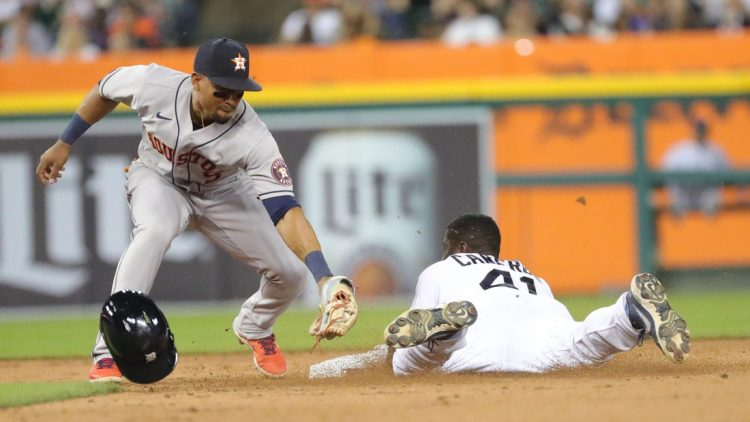 Detroit Tigers center fielder Daz Cameron (41) slides onto second ahead of the tag by Houston Astros shortstop Carlos Correa (1) during sixth inning action on Thursday, June 24, 2021, at Comerica Park in Detroit.Tigershou1