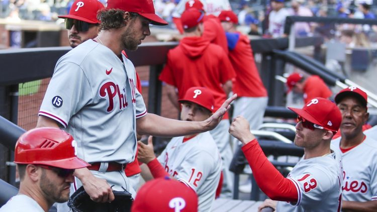 Jun 25, 2021; New York City, New York, USA; Philadelphia Phillies pitcher Aaron Nola (27) is greeted by infielder Brad Miller (13) in the fourth inning after tying Tom Seaver s National League record with 10 consecutive strikeouts against the New York Mets at Citi Field. Mandatory Credit: Wendell Cruz-USA TODAY Sports
