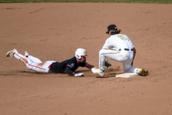 Jun 25, 2021; Omaha, Nebraska, USA;  Vanderbilt Commodores infielder Carter Young (9) tags out NC State Wolfpack first baseman Sam Highfill (17) on a pick off in the seventh inning at TD Ameritrade Park. Mandatory Credit: Steven Branscombe-USA TODAY Sports