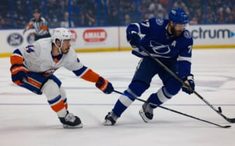 Jun 25, 2021; Tampa, Florida, USA; Tampa Bay Lightning defenseman Victor Hedman (77) handles the puck past New York Islanders center Jean-Gabriel Pageau (44) during the first period in game seven of the Stanley Cup Semifinals at Amalie Arena. Mandatory Credit: Nathan Ray Seebeck-USA TODAY Sports