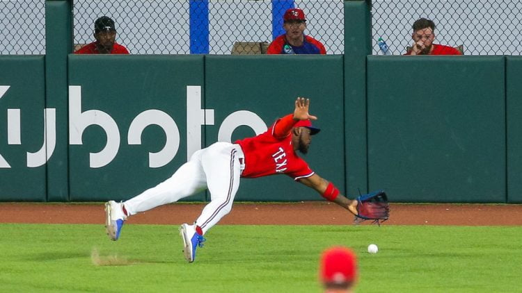 Jun 25, 2021; Arlington, Texas, USA; Texas Rangers center fielder Adolis Garcia (53) dives for a ball during the third inning against the Kansas City Royals at Globe Life Field. Mandatory Credit: Andrew Dieb-USA TODAY Sports