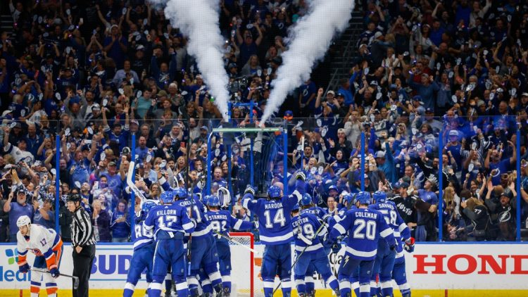 Jun 25, 2021; Tampa, Florida, USA; Tampa Bay Lightning celebrate after beating the New York Islanders 1-0 in game seven of the Stanley Cup Semifinals at Amalie Arena. Mandatory Credit: Nathan Ray Seebeck-USA TODAY Sports