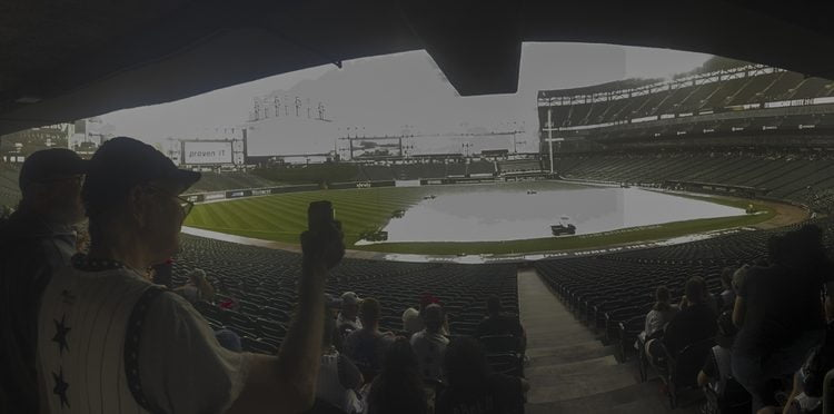 Jun 26, 2021; Chicago, Illinois, USA;  Fans wait out a rain delay before the game between the Chicago White Sox and the Seattle Mariners at Guaranteed Rate Field. Mandatory Credit: Matt Marton-USA TODAY Sports