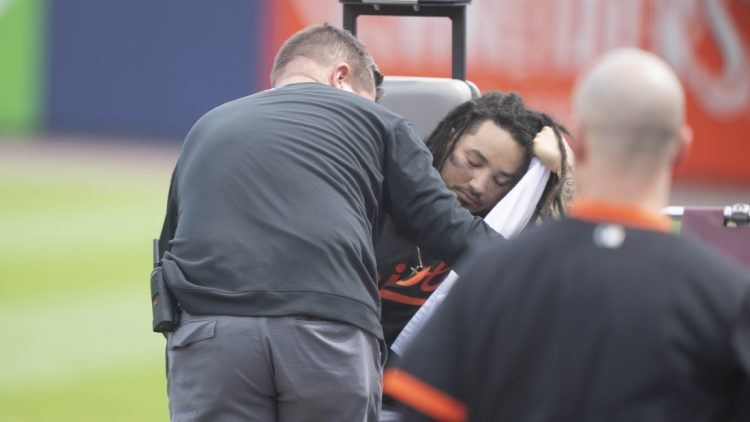 Jun 26, 2021; Buffalo, New York, CAN; Baltimore Orioles Shortstop Freddy Galvis (2) is carted off the field after injuring his ankle during the second inning against the Toronto Blue Jays at Sahlen Field. Mandatory Credit: Gregory Fisher-USA TODAY Sports