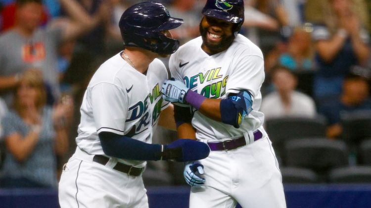 Jun 26, 2021; St. Petersburg, Florida, USA;  Tampa Bay Rays designated hitter Austin Meadows (17) congratulates  right fielder Manuel Margot (13) after hitting a two run home run in the second inning against the Los Angeles Angels Tropicana Field. Mandatory Credit: Nathan Ray Seebeck-USA TODAY Sports