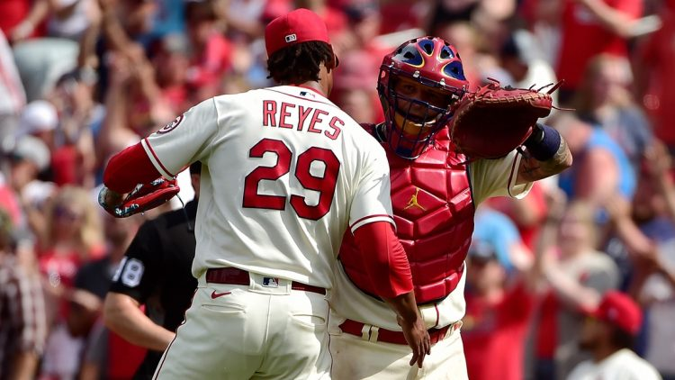 Jun 26, 2021; St. Louis, Missouri, USA;  St. Louis Cardinals catcher Yadier Molina (4) celebrates with relief pitcher Alex Reyes (29) after the Cardinals defeated the Pittsburgh Pirates at Busch Stadium. Mandatory Credit: Jeff Curry-USA TODAY Sports