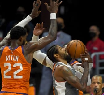 Jun 26, 2021; Los Angeles, California, USA; Los Angeles Clippers guard Paul George (13) drives to the basket against Phoenix Suns center Deandre Ayton (22) and forward Jae Crowder (99) in the first half of game four of the Western Conference Finals for the 2021 NBA Playoffs at Staples Center. Mandatory Credit: Jayne Kamin-Oncea-USA TODAY Sports
