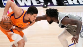 Jun 26, 2021; Los Angeles, California, USA; Phoenix Suns guard Devin Booker (1) and LA Clippers guard Patrick Beverley (21) face off during the fourth quarter of game four of the Western Conference Finals for the 2021 NBA Playoffs at Staples Center. Mandatory Credit: Robert Hanashiro-USA TODAY Sports