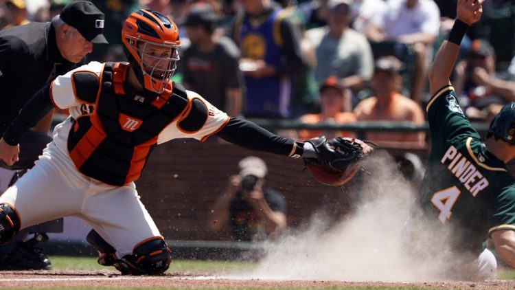Jun 27, 2021; San Francisco, California, USA; San Francisco Giants catcher Buster Posey (28) misses a tag as Oakland Athletics left fielder Chad Pinder (4) scores a run during the sixth inning at Oracle Park. Mandatory Credit: Darren Yamashita-USA TODAY Sports