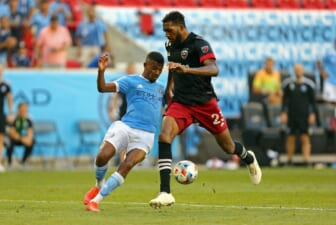Jun 27, 2021; Harrison, New Jersey, USA; New York City FC forward Thiago Andrade (8) kicks the game-winning goal while D.C. United defender Donovan Pines (23) tries to defend during the second half of a game between D.C. United and NYCFC at Red Bull Arena. Mandatory Credit: Danny Wild-USA TODAY Sports