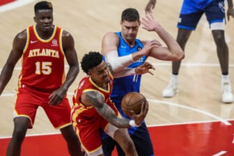 Jun 27, 2021; Atlanta, Georgia, USA; Atlanta Hawks forward John Collins (20) competes for rebound against Milwaukee Bucks center Brook Lopez (11) during the first quarter during game three of the Eastern Conference Finals for the 2021 NBA Playoffs at State Farm Arena. Mandatory Credit: Dale Zanine-USA TODAY Sports