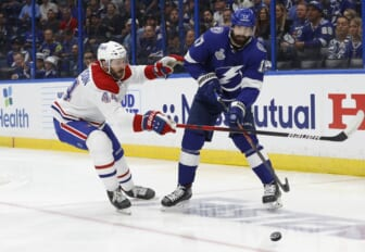 Jun 28, 2021; Tampa, Florida, USA; Tampa Bay Lightning left wing Alex Killorn (17) passes the puck away from Montreal Canadiens defenseman Joel Edmundson (44) in the second period of game one of the 2021 Stanley Cup Final at Amalie Arena. Mandatory Credit: Kim Klement-USA TODAY Sports