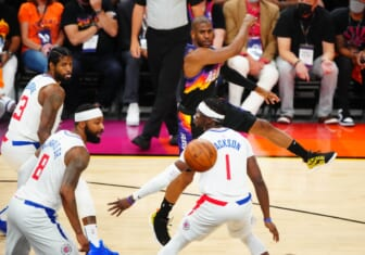 Jun 28, 2021; Phoenix, Arizona, USA; Phoenix Suns guard Chris Paul passes the ball against the Los Angeles Clippers in the first half during game five of the Western Conference Finals for the 2021 NBA Playoffs at Phoenix Suns Arena. Mandatory Credit: Mark J. Rebilas-USA TODAY Sports