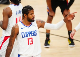 Jun 28, 2021; Phoenix, Arizona, USA; Los Angeles Clippers guard Paul George (13) against the Phoenix Suns in the first half during game five of the Western Conference Finals for the 2021 NBA Playoffs at Phoenix Suns Arena. Mandatory Credit: Mark J. Rebilas-USA TODAY Sports