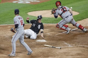 Jun 29, 2021; Chicago, Illinois, USA; Chicago White Sox catcher Zack Collins (21) scores a run as Minnesota Twins catcher Ryan Jeffers (27) waits for the ball during the fifth inning at Guaranteed Rate Field. Mandatory Credit: Kamil Krzaczynski-USA TODAY Sports