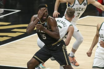 Jun 29, 2021; Atlanta, Georgia, USA; Atlanta Hawks center Clint Capela (15) reaches to being hit in his face against Milwaukee Bucks guard Sam Merrill (15) in the fourth quarter during game four of the Eastern Conference Finals for the 2021 NBA Playoffs at State Farm Arena. Mandatory Credit: Brett Davis-USA TODAY Sports