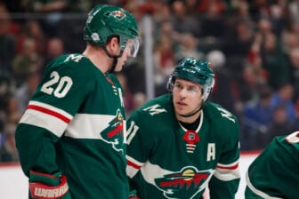 Feb 27, 2018; Saint Paul, MN, USA; Minnesota Wild forward Zach Parise (11) talks to defenseman Ryan Suter (20) in the first period against the St Louis Blues at Xcel Energy Center. Mandatory Credit: Brad Rempel-USA TODAY Sports