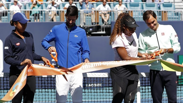 Mar 20, 2019; Miami Gardens, FL, USA; (L-R) Naomi Osaka of Japan, Novak Djokovic of Serbia, Serena Williams of the United States, and Roger Federer of Switzerland participate in a ribbon cutting ceremony on new stadium court at Hard Rock Stadium prior to play in the first round of the Miami Open at Miami Open Tennis Complex. Mandatory Credit: Geoff Burke-USA TODAY Sports