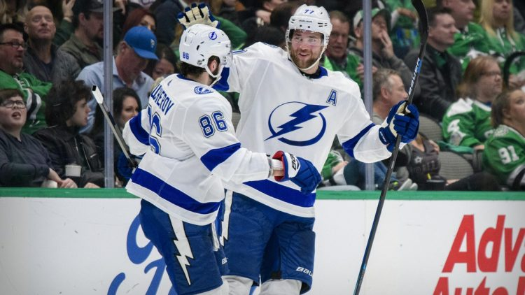 Jan 27, 2020; Dallas, Texas, USA; Tampa Bay Lightning right wing Nikita Kucherov (86) and defenseman Victor Hedman (77) celebrate a goal during the game between the Stars and the Lightning at the American Airlines Center. Mandatory Credit: Jerome Miron-USA TODAY Sports