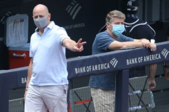 Jul 16, 2020; Bronx, New York, United States; New York Yankees general manager Brian Cashman (left) and owner Hal Steinbrenner watch live batting practice during summer camp workouts at Yankee Stadium. Mandatory Credit: Brad Penner-USA TODAY Sports