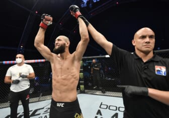 July 26, 2020; Abu Dhabi, UAE; Khamzat Chimaev (red gloves) of Czechia celebrates after his TKO victory over Rhys McKee (not pictured) of Northern Ireland in their welterweight fight during the UFC Fight Night event inside Flash Forum on UFC Fight Island .  Mandatory Credit: Jeff Bottari/Zuffa LLC via USA TODAY Sports
