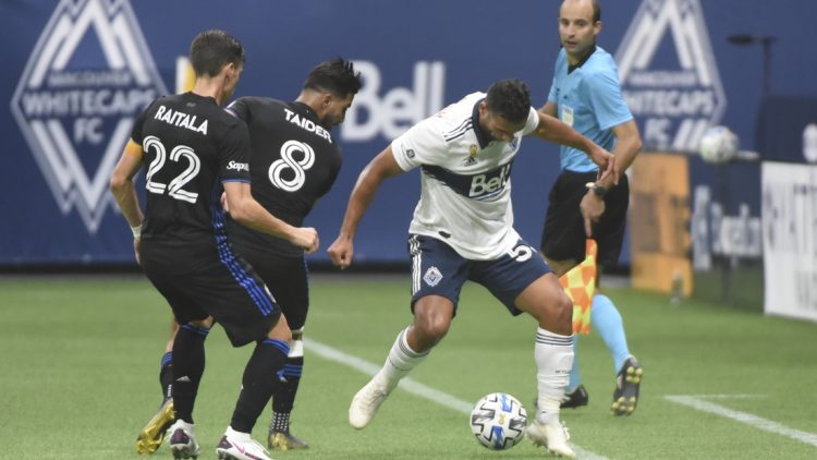 Sep 16, 2020; Vancouver, British Columbia, CAN;  Montreal Impact defender Jukka Raitala (22) and midfielder Saphir Taider (8) defend against Vancouver Whitecaps defender Ali Adnan (53) during the second half at BC Place. Mandatory Credit: Anne-Marie Sorvin-USA TODAY Sports