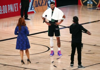 Sep 25, 2020; Lake Buena Vista, Florida, USA; Boston Celtics forward Jayson Tatum (0) is interviewed by sideline reporter Rachel Nichols following game five of the Eastern Conference Finals of the 2020 NBA Playoffs at AdventHealth Arena. Mandatory Credit: Kim Klement-USA TODAY Sports