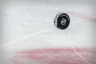 Jan 26, 2021; Dallas, Texas, USA; A view of a puck and the NHL logo and the face-off circle before the game between the Dallas Stars and the Detroit Red Wings at the American Airlines Center. Mandatory Credit: Jerome Miron-USA TODAY Sports