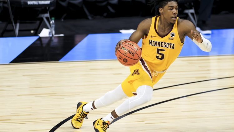 Mar 10, 2021; Indianapolis, Indiana, USA; Minnesota Golden Gophers guard Marcus Carr (5) drives to the basket against the Northwestern Wildcats in the second half at Lucas Oil Stadium. Mandatory Credit: Aaron Doster-USA TODAY Sports