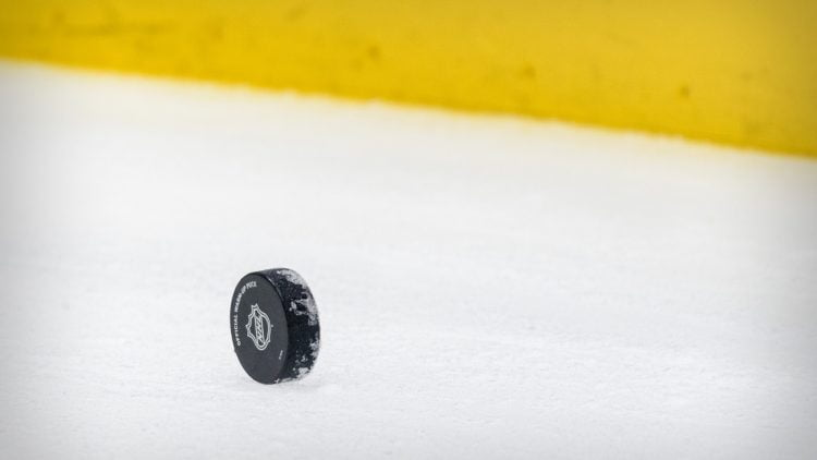 Apr 20, 2021; Dallas, Texas, USA; A view of a hockey puck and yellow boards before the game between the Dallas Stars and the Detroit Red Wings at the American Airlines Center. Mandatory Credit: Jerome Miron-USA TODAY Sports