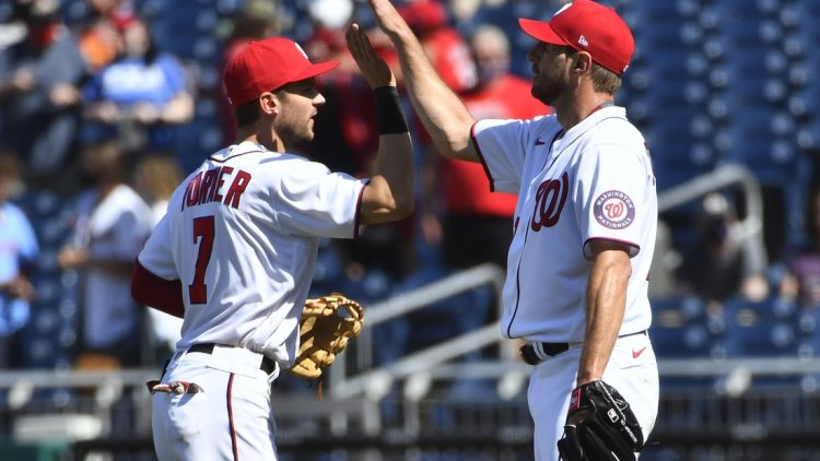 May 2, 2021; Washington, District of Columbia, USA; Washington Nationals starting pitcher Max Scherzer (31) is congratulated by shortstop Trea Turner (7) after the game against the Miami Marlins at Nationals Park. Mandatory Credit: Brad Mills-USA TODAY Sports