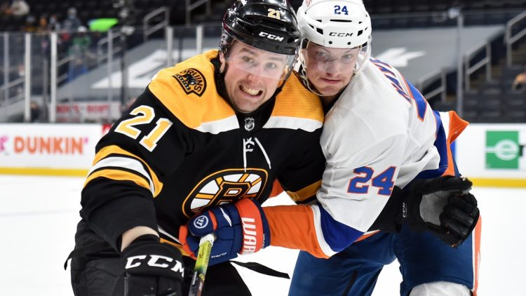 May 10, 2021; Boston, Massachusetts, USA;  Boston Bruins left wing Nick Ritchie (21) and New York Islanders defenseman Nick Leddy (2) battle for position during the second period at TD Garden. Mandatory Credit: Bob DeChiara-USA TODAY Sports