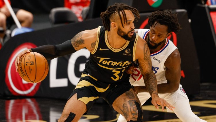 May 11, 2021; Tampa, Florida, USA;  Toronto Raptors guard Gary Trent Jr. (33) dribbles the ball against LA Clippers guard Patrick Beverley (21) in the first quarter at Amalie Arena. Mandatory Credit: Nathan Ray Seebeck-USA TODAY Sports