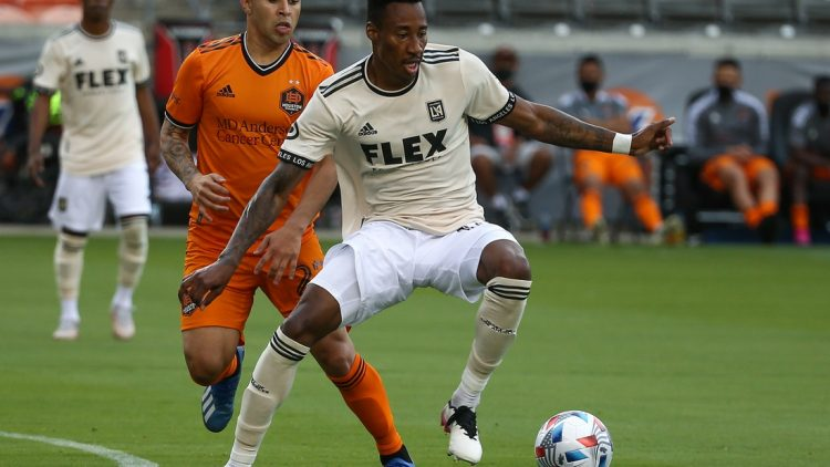 May 1, 2021; Houston, Texas, USA; Los Angeles FC midfielder Mark-Anthony Kaye (14) in action during the match against the Houston Dynamo FC at BBVA Stadium. Mandatory Credit: Troy Taormina-USA TODAY Sports