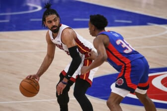 May 16, 2021; Detroit, Michigan, USA; Miami Heat guard Gabe Vincent (2) drives to the basket as Detroit Pistons guard Saben Lee (38) defends during the fourth quarter at Little Caesars Arena. Mandatory Credit: Tim Fuller-USA TODAY Sports