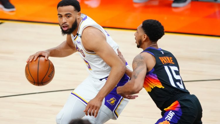 May 23, 2021; Phoenix, Arizona, USA; Los Angeles Lakers guard Talen Horton-Tucker (5) against Phoenix Suns guard Cameron Payne (15) during game one in the first round of the 2021 NBA Playoffs. at Phoenix Suns Arena. Mandatory Credit: Mark J. Rebilas-USA TODAY Sports